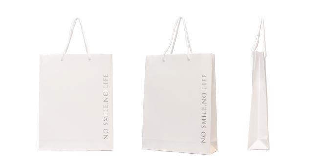 歯科医院様のシンプル×贅沢なオリジナル紙袋の制作事例