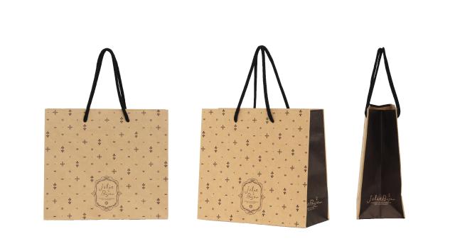 化粧品卸売店様の宝石柄をちりばめたようなオリジナル紙袋の制作事例