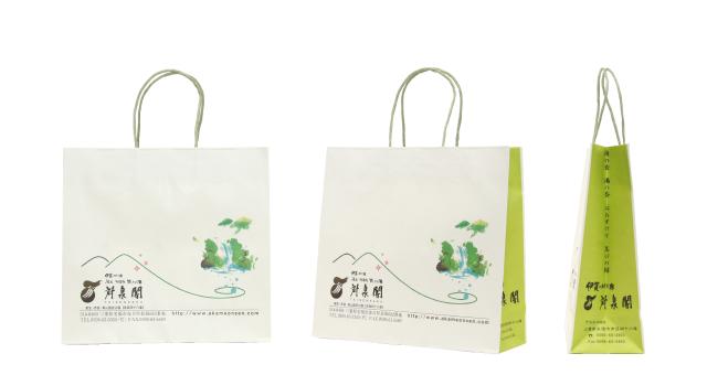 旅館様の旅情あふれる若草色のオリジナル紙袋の制作事例